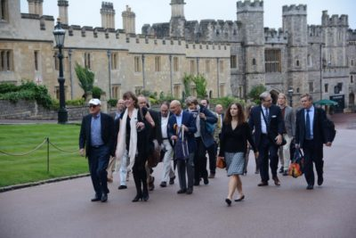 Group of researchers and GPP partners walk outside Windsor Castle