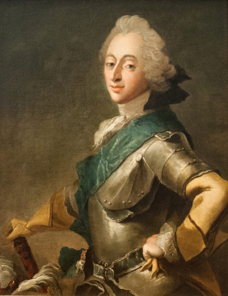 man in armor with blue sash
